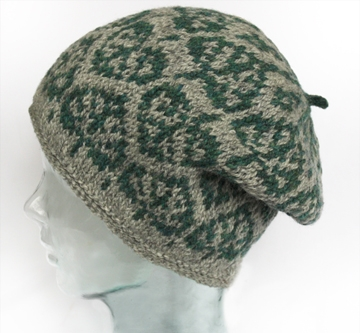 aspen leaf motif in grey and green, slouched on glass mannequin head