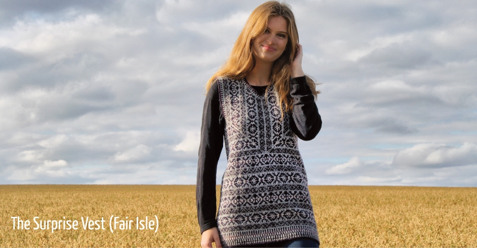 Image of female model in Fair Isle Surprise vest in farm field with big clouds