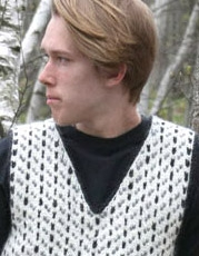 guy wearing black, gray, cream faroe vest