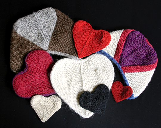 group of knitted heart garments