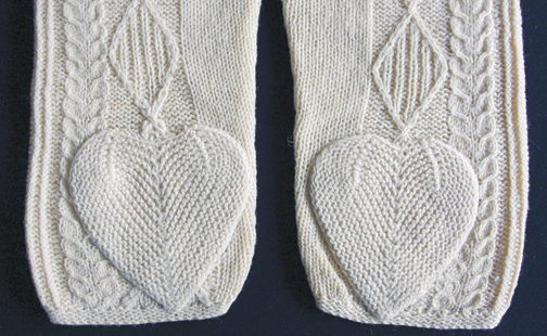 knitted hearts on knitted sweater sleeves