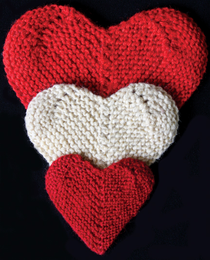 Three knitted hearts red and cream