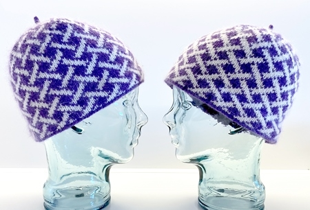 hats on glass heads in same colors but showing difference in color based on shifting the light and dark when knit