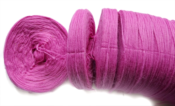 breaking apart bun of pink unspun icelandic wool