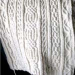 sample of twisted stitch knitting in cream wool