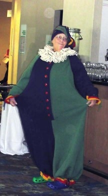 Bridget Rorem in her knitted clown suit of blues, greens, yellows, reds
