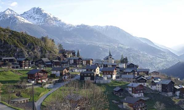 A village in Italy with steepled houses and mountains