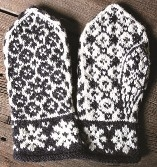 black and white patterned selbu style mittens palm and back, flowered pattern